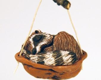 sleeping raccoon ornament