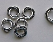 Eight 8mm Sterling Silver Triple Twisted Closed Jump Rings with an Extra Twist