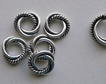 Eight 10mm Sterling Silver Triple Twisted Closed Jump rings with an Extra Twist