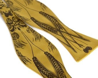 "Beer bow tie. Golden yellow ""lager"" print. Screenprinted hops barley and wheat freestyle self-tie style."