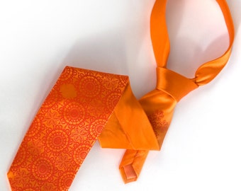 Carrot orange men's tie, Cottage Lace. Tangerine tango silkscreened necktie. Dark coral print on microfiber.