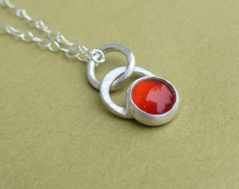 Tiny Dot of Red. Glowing Carnelian.