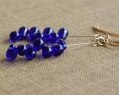 cobalt anemone dangle earrings (blue glass. gold filled wire)