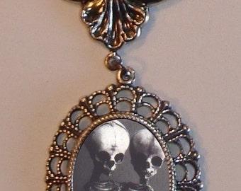 Beautiful Victorian SIAMESE SKELETONS Victorian Silver-Tone Filigree Necklace Pendant