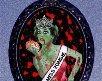 Miss ZOMBIE GIRL Pinup Necklace Holding brains Beauty Pageant Winner Bloody Background Psychobilly Horror Goth Pinup Necklace