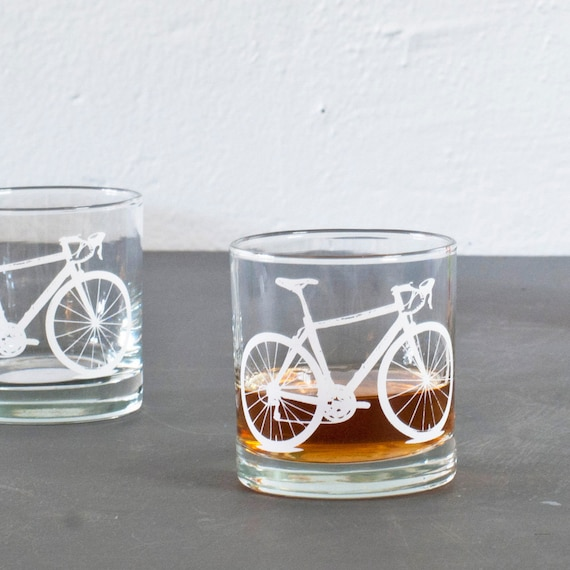 4 bike rocks or pint glasses, white bicycle