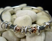 Handmade sterling silver and copper jingle jangle bangle mixed metal jewellery