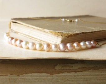 An aisle Of pearls Necklace - Shaded freshwater pearls on 14k gold line