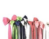 Colored wedding sash.