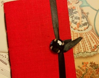 Red silk Journal, Fabric Notebook handmade with lined paper, opens with a black faceted button and black ribbon