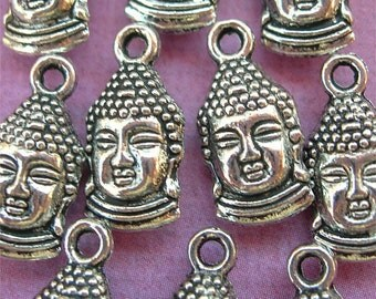 Tiny Buddha Head Charms in silver lot of 10