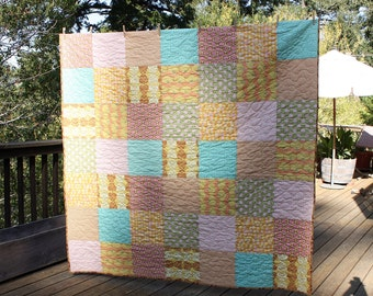 Custom Throw Sized Patchwork Quilt Featuring Your Choice From Available Fabrics.  Professionally Quilted.