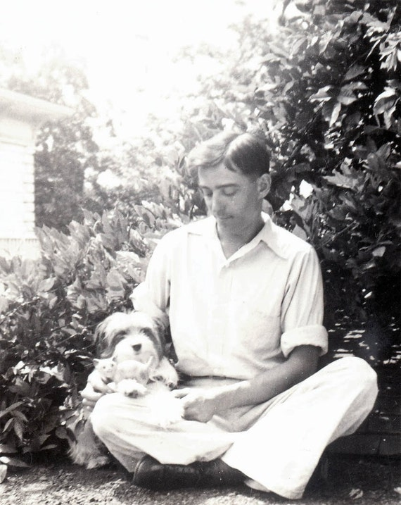 vintage photo young man w his Cockapoo Dog in Lap