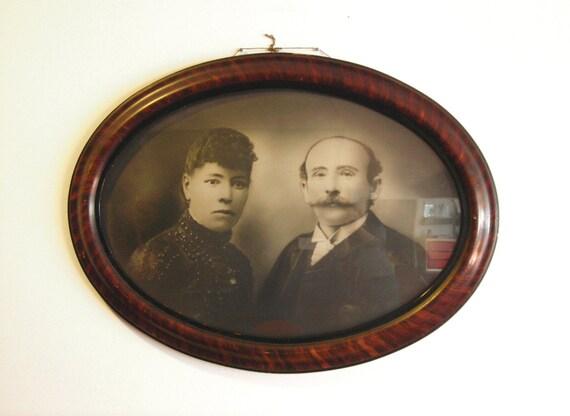 Antique Black & White Photograph in Bubble Glass Frame. Odd Couple, Creepy Portraits. Victorian Woman, Moustache Man. Dark, Moody, Strange.