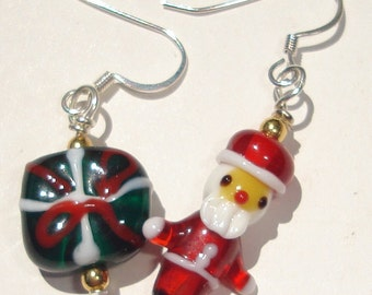 Santa and a gift lampwork glass bead hand made wire wrapped pierced dangle Christmas earrings affordable unique Merry Christmas