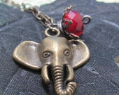 Two suns in a sunset red crystal and brass elephant necklace
