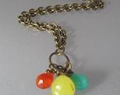 True Colors. Orange carnelian, green jade, and blue glass, bead necklace.