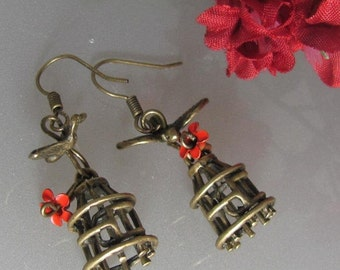 Stay (bird cage and free bird earrings)