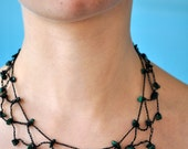 Black mesh necklace with malachite