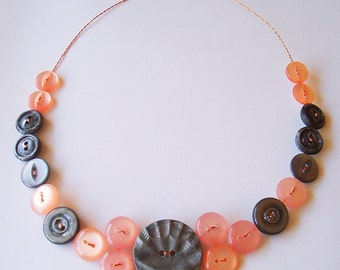 Necklace of vintage buttons in grey and peach
