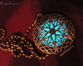 Aqua Glow in the Dark Mystic Antiqued Brass Filigree Glow Locket®