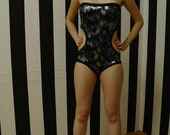 MASQ Swimwear black and metallic blue/silver colours hole monokini. Size S M L