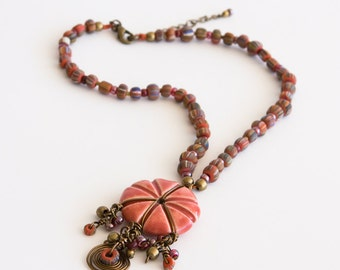Beaded Necklace in Coral Orange and Bronze with Ceramic Pendant, Wire Charm and Color Striped Beads. One Of A Kind Tribal Ethnic Style S114