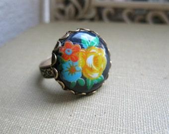 Vintage glass ring, black flower cabochon, adjustable band, colorful flower bouquet