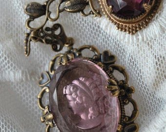 Asymetrical intaglio necklace with three amathyst purple vintage glass jewels set in brass Statement jewelry
