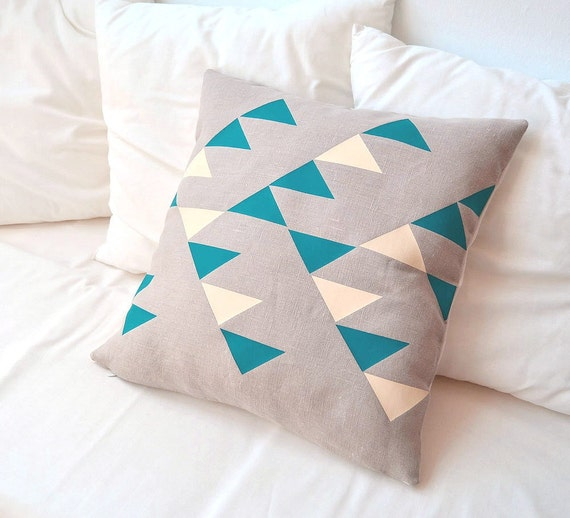 Decorative pattern in natural beige linen pillow cover inspired by tribal designs