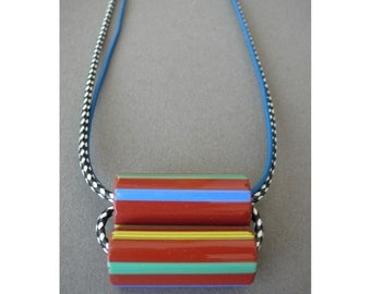 Long patterned necklace with striped African glass on leather and nylon