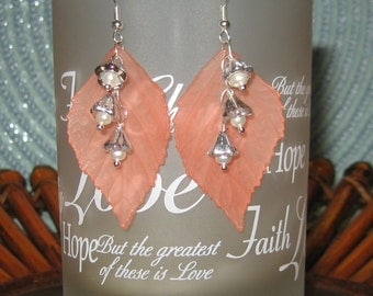 Peach Lucite Leaves With Wire Wrap Dangling Silver Flowers With Fresh Water Pearl Centers.