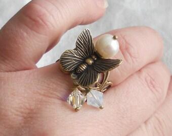 osO SPHINX Oso pearl swarovski butterfly brass ring