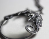 Ariel. Conjoined seahorse spyglass necklace.