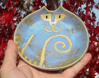 Pottery Cat plate round dish handmade clay rustic moody blue yellow eyes