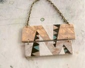 Hand painted geometric necklace. Soft colors.