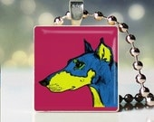 Scrabble tile pendant of Andy Warhol style Doberman Pincher