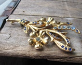 antique dark and light blue rhinestone brooch - gold tone vintage jewelry from the 1940s