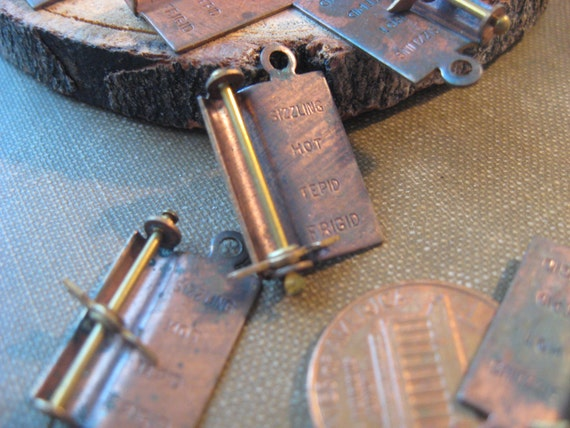 lot of 4 movable hotness charms heat meter vintage patina antique