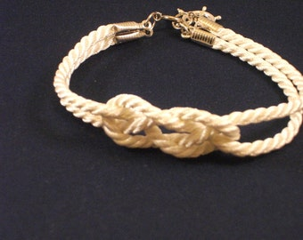 Ivory cream double infinity knot nautical rope bracelet with silver ship wheel charm