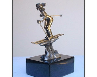 Mountain Muse Spring Skiing sculpture nude skier captured in bronze