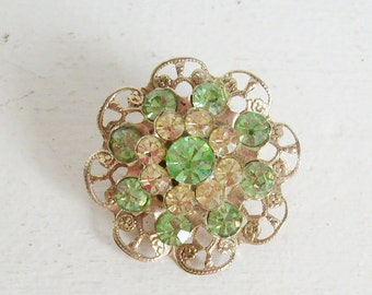 Vintage rhinestone filigree brooch or pin green and gold round