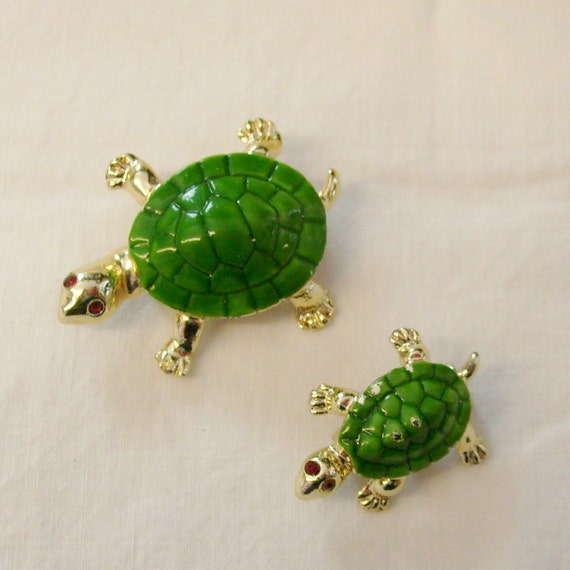 Vintage turtle enamel scatter pins with rhinestone eyes.