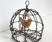Tiny Hand Carved Wooden Bird in a Round Wire Cage