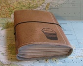 bucket list journal with world atlas maps as travel journal