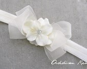 The Bridgit sheer ivory bow with flower center on a ivory soft stetch ribbon headband infant/toddler/baby/newborn your choice of size