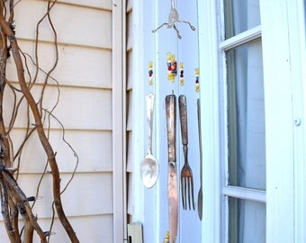 UniQue WINDCHIMES  Wind Chimes from REcYcLed /REpurposed SILVERWARE w/ Tiny Food Can beads and red,yellow,black,white  gLass BeaDs