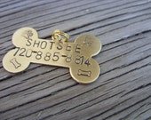 Hand stamped brass dog tag bone  with name and phone number 19x32mm
