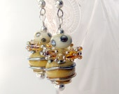 """Handmade lampwork earrings. """"Bumble Bees"""". Globes and discs, with silver trim."""