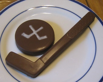 Solid chocolate hockey stick and hockey puck